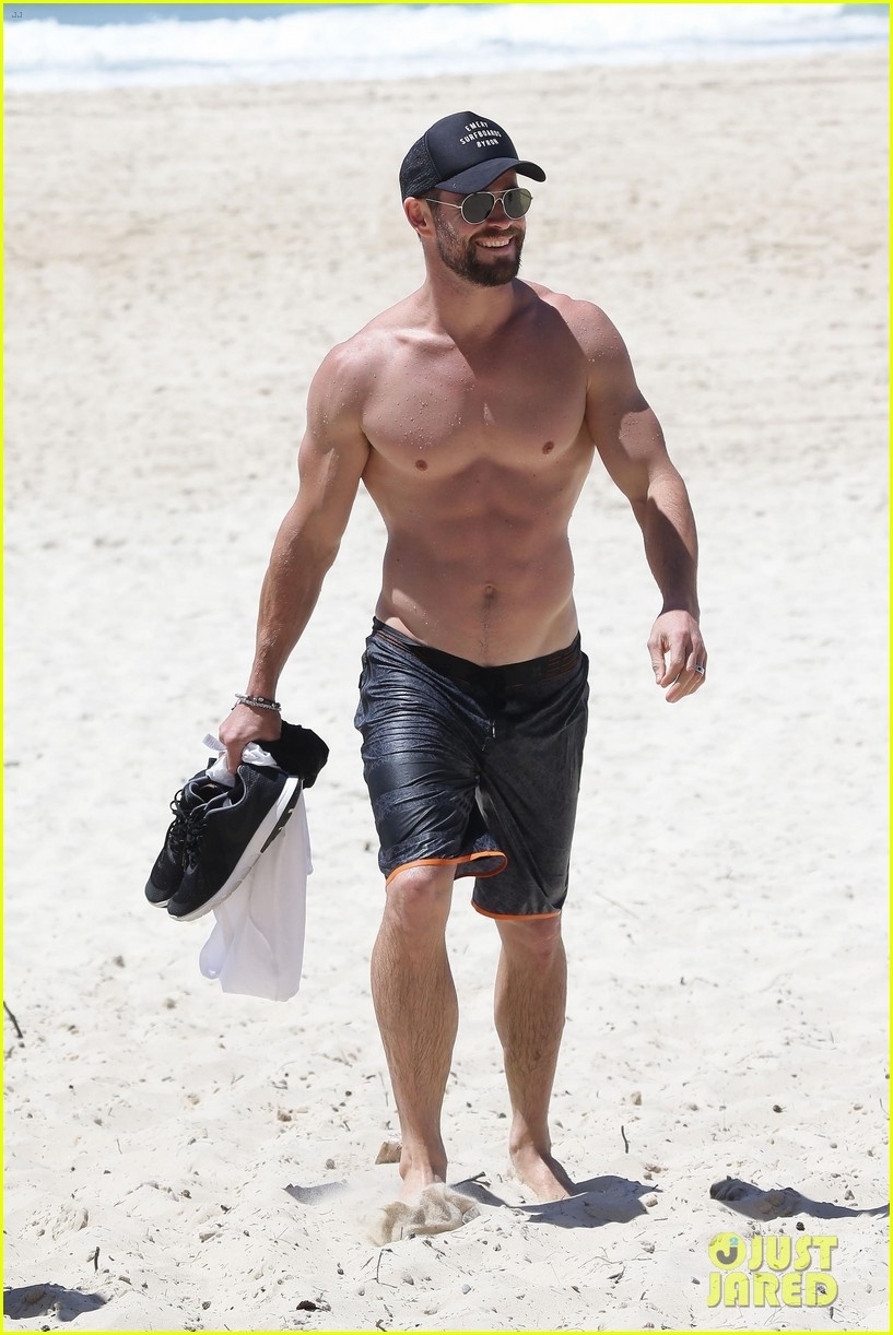 chris hemsworth goes shirtless at beach in australia 083972248