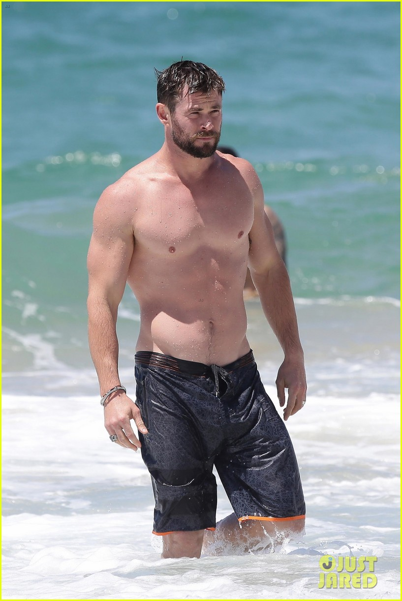 chris hemsworth goes shirtless at beach in australia 153972255