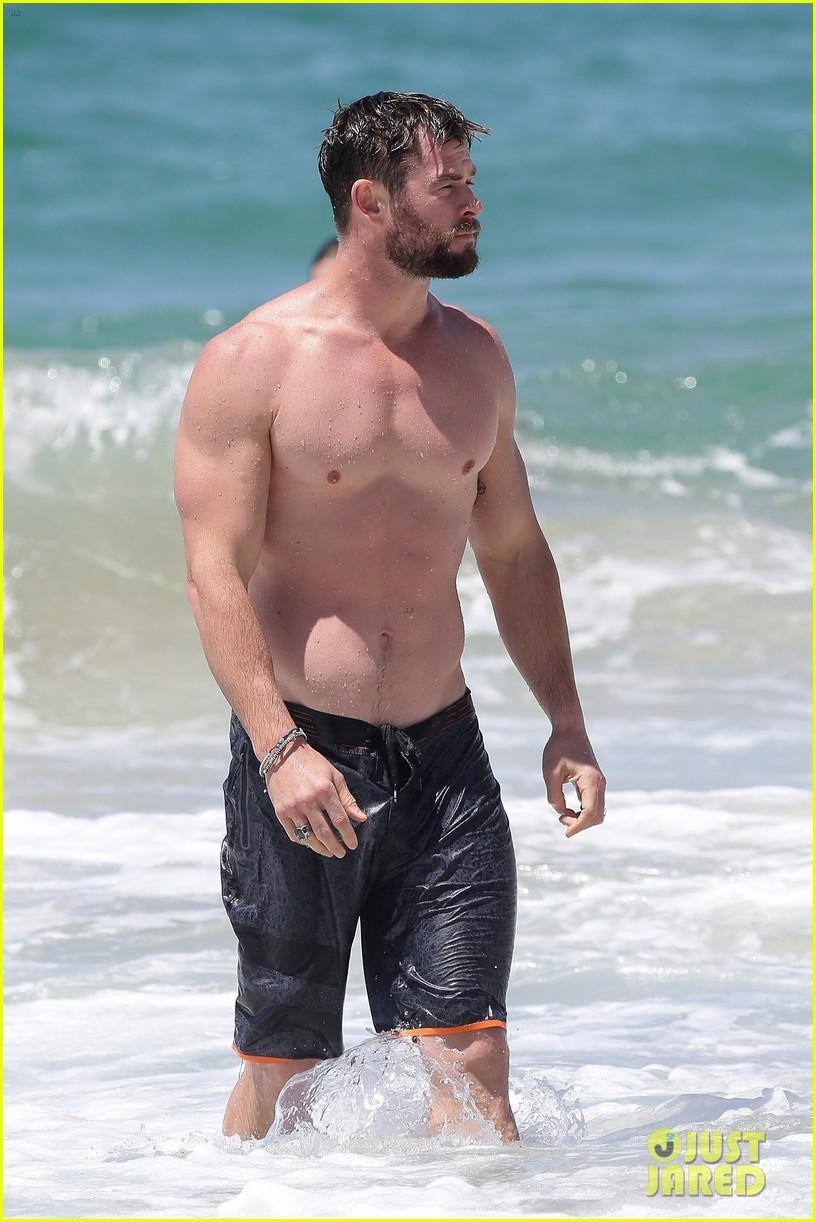 chris hemsworth goes shirtless at beach in australia 173972257