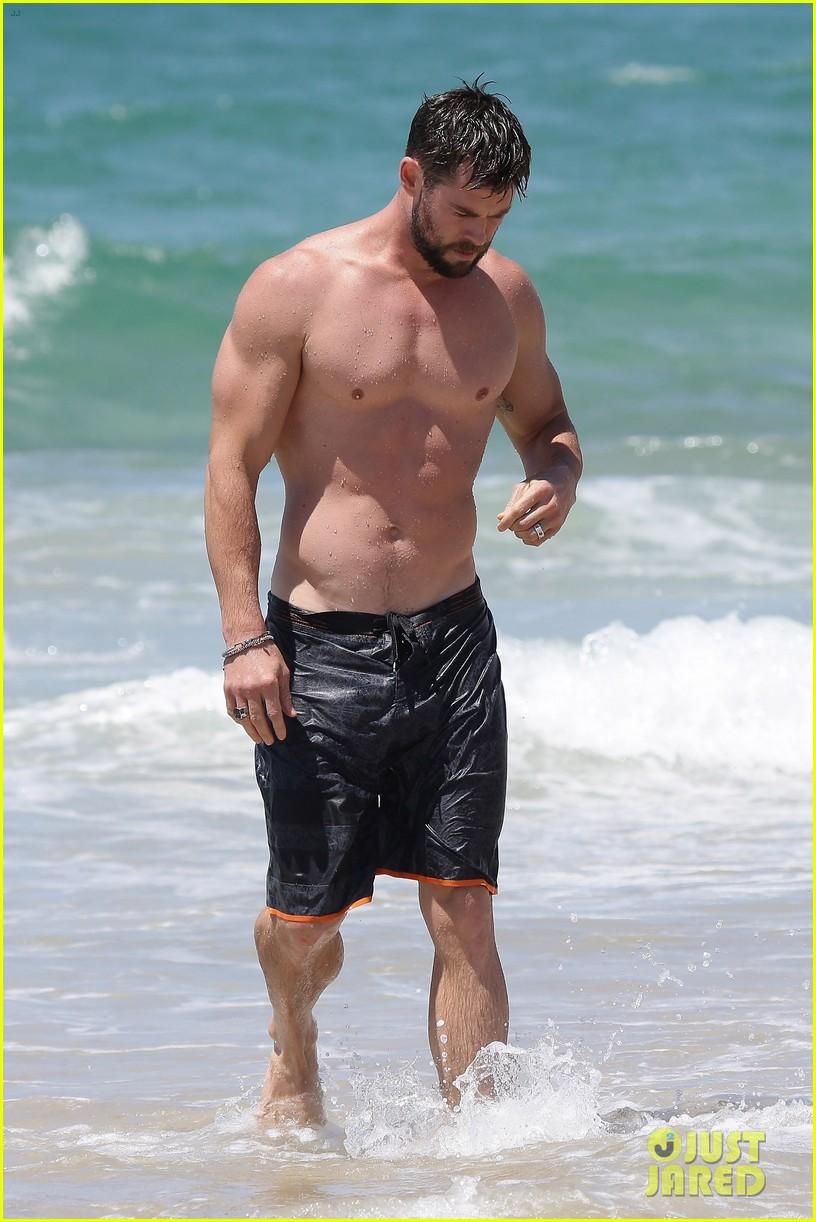 chris hemsworth goes shirtless at beach in australia 183972258