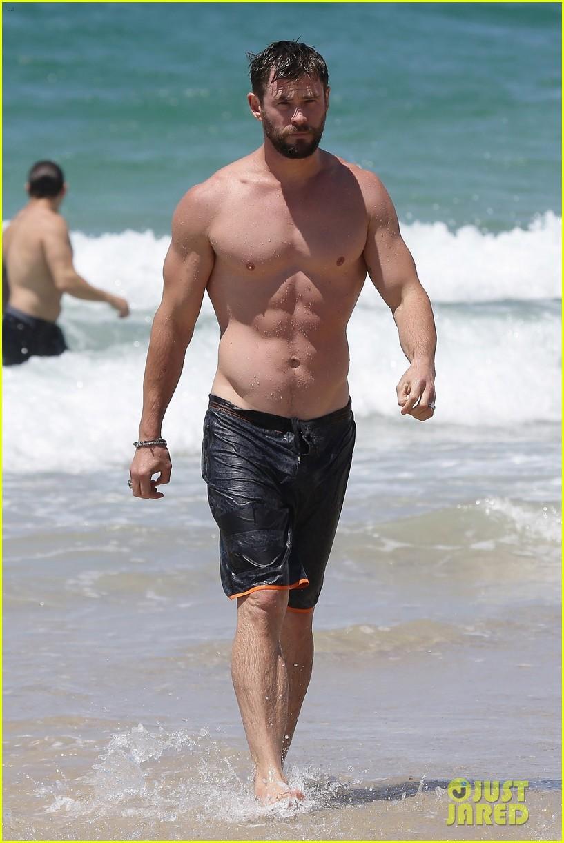 chris hemsworth goes shirtless at beach in australia 193972259