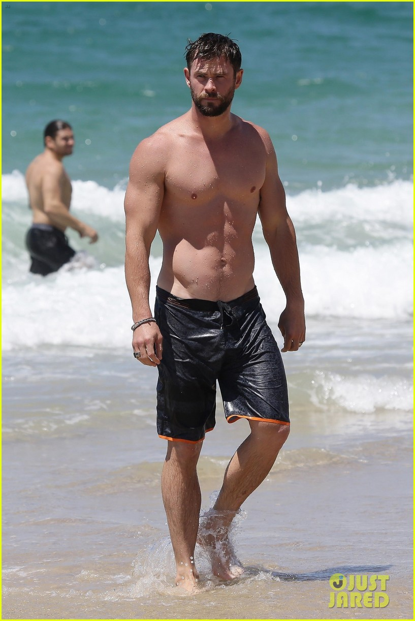 chris hemsworth goes shirtless at beach in australia 203972260