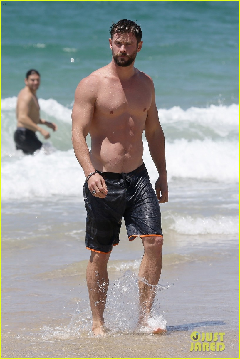 chris hemsworth goes shirtless at beach in australia 213972261