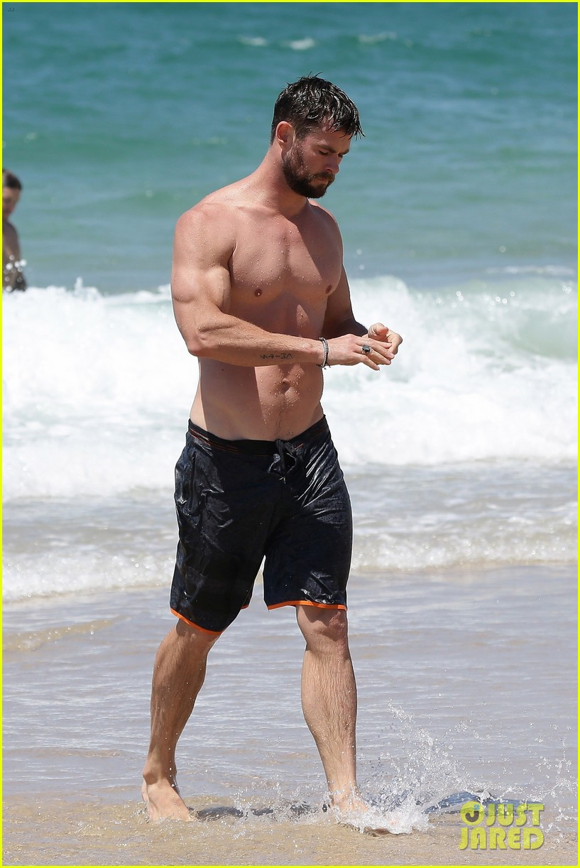 chris hemsworth goes shirtless at beach in australia 223972262