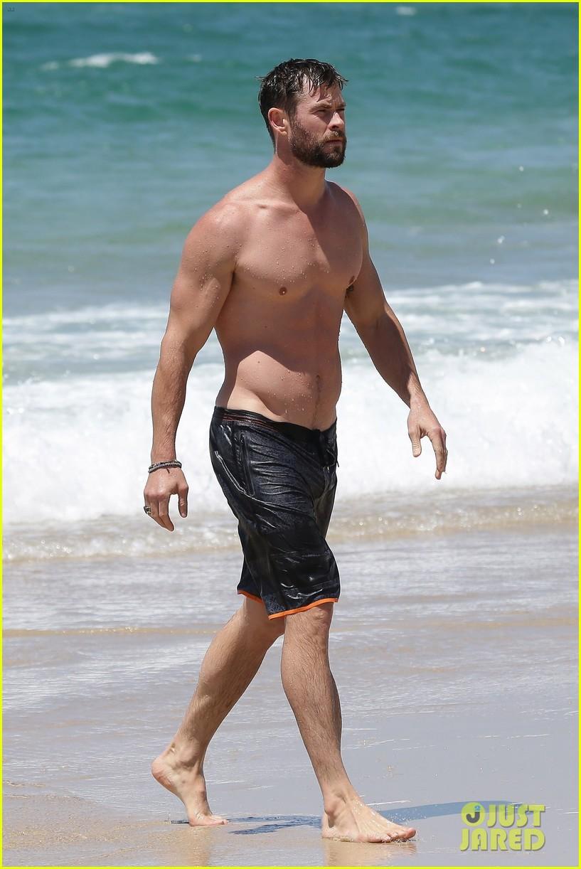 chris hemsworth goes shirtless at beach in australia 233972263