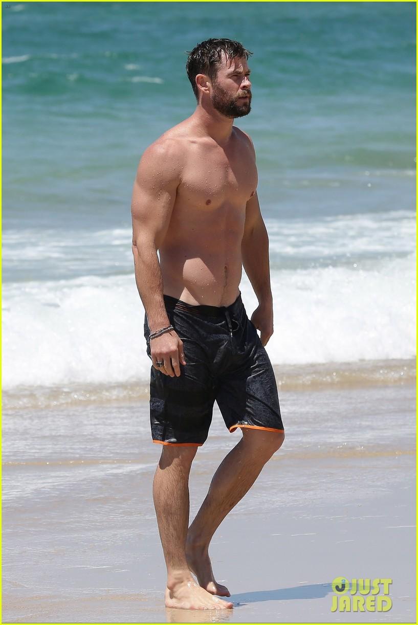 chris hemsworth goes shirtless at beach in australia 243972264