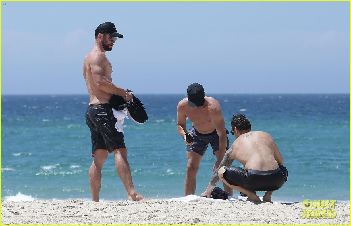 chris hemsworth goes shirtless at beach in australia 253972265