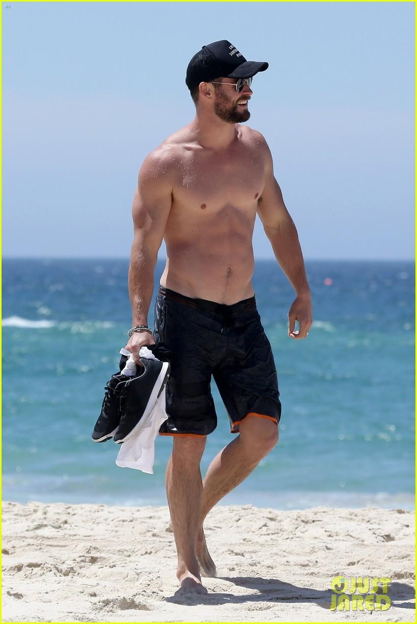 chris hemsworth goes shirtless at beach in australia 273972267