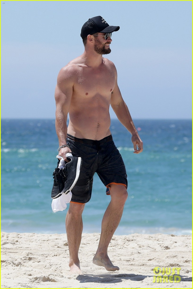 chris hemsworth goes shirtless at beach in australia 283972268