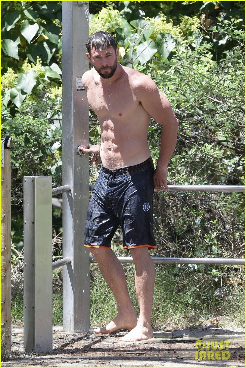 chris hemsworth goes shirtless at beach in australia 313972271
