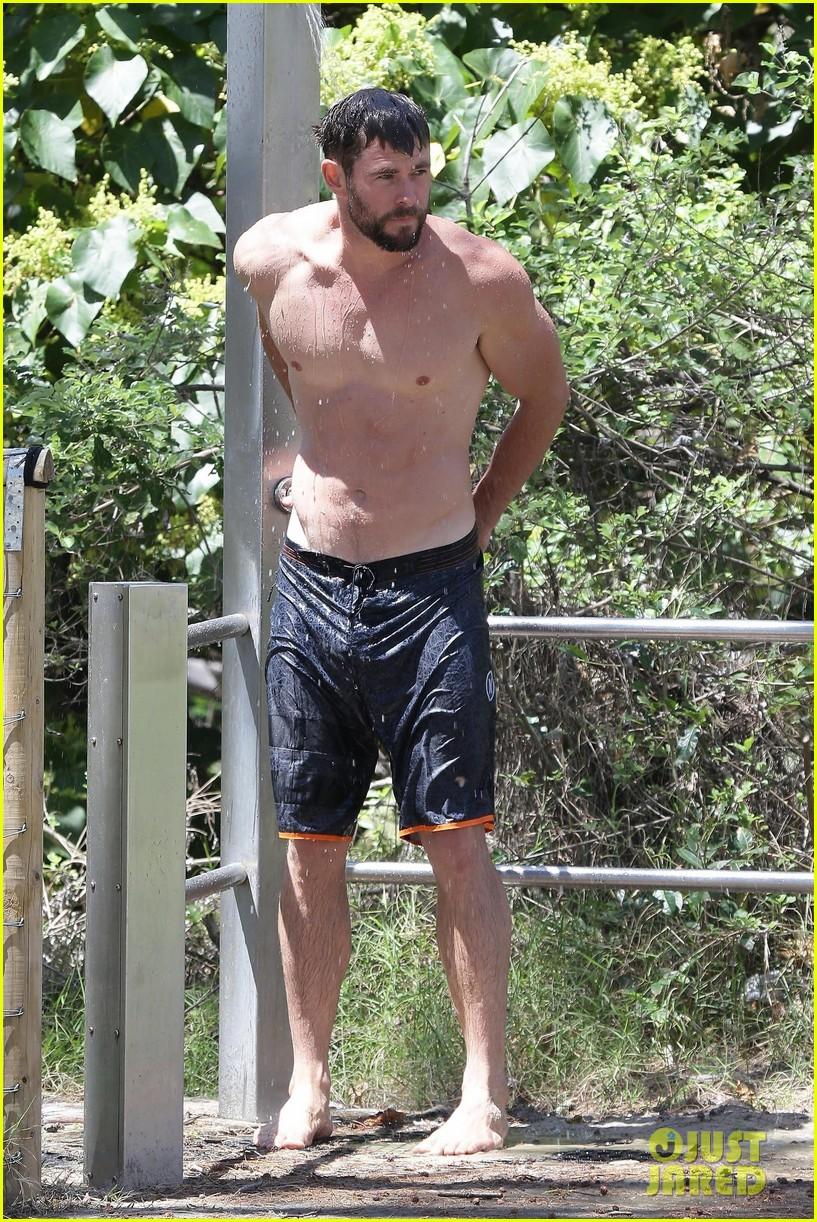 chris hemsworth goes shirtless at beach in australia 333972273