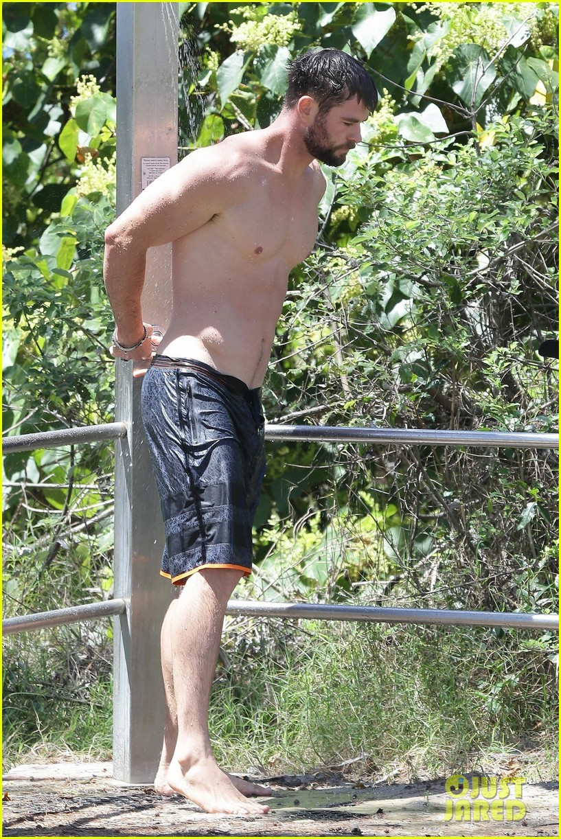 chris hemsworth goes shirtless at beach in australia 353972275