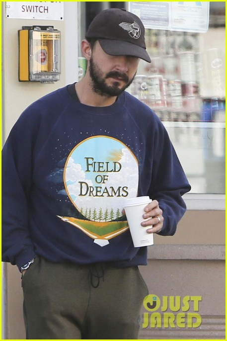 shia labeouf keeps a low profile for his flight into lax 023976112