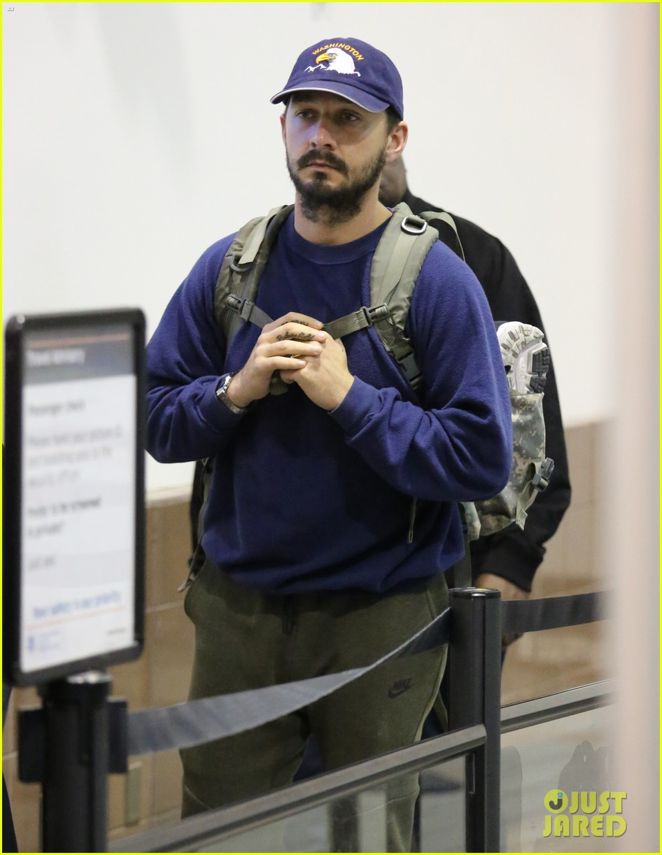 shia labeouf keeps a low profile for his flight into lax 043976114