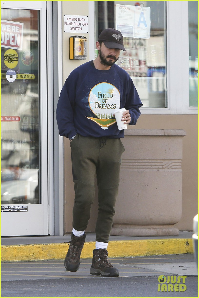 shia labeouf keeps a low profile for his flight into lax 053976115