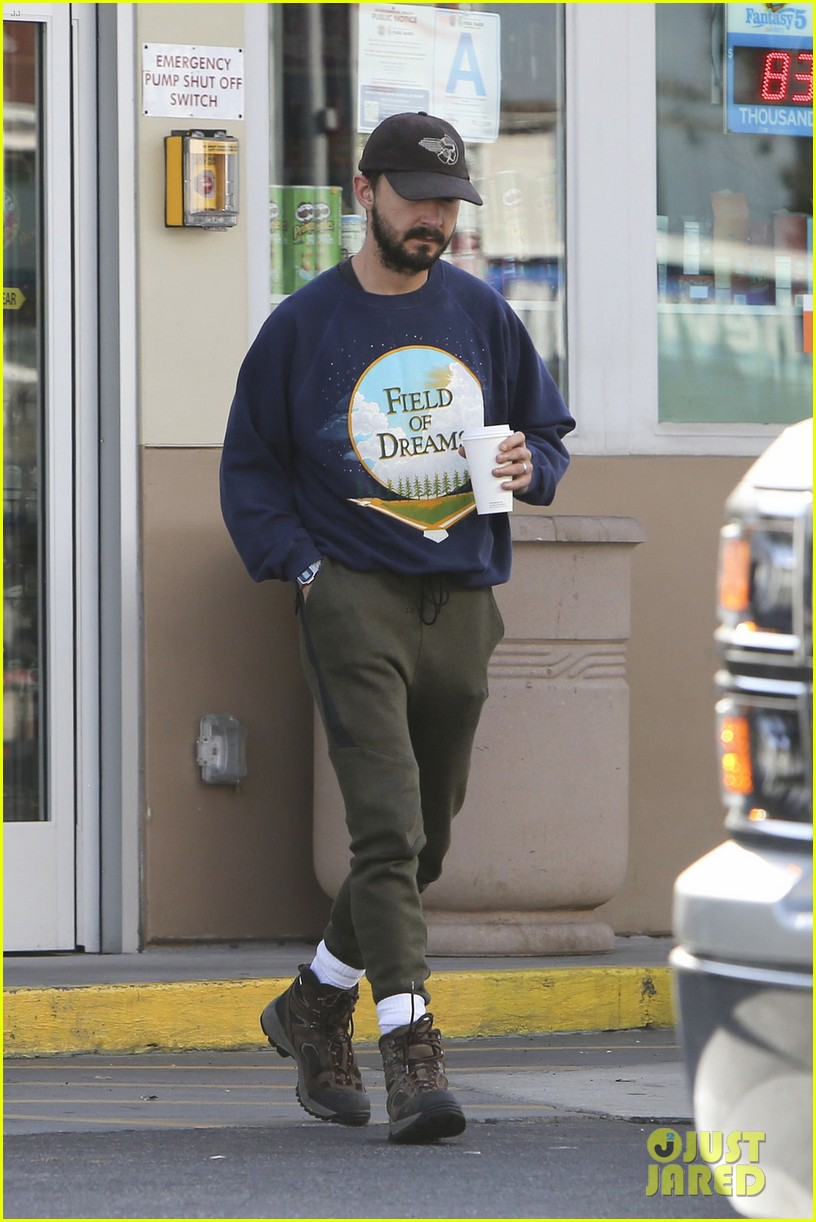 shia labeouf keeps a low profile for his flight into lax 073976117