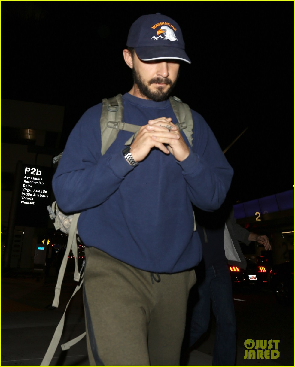 shia labeouf keeps a low profile for his flight into lax 103976120