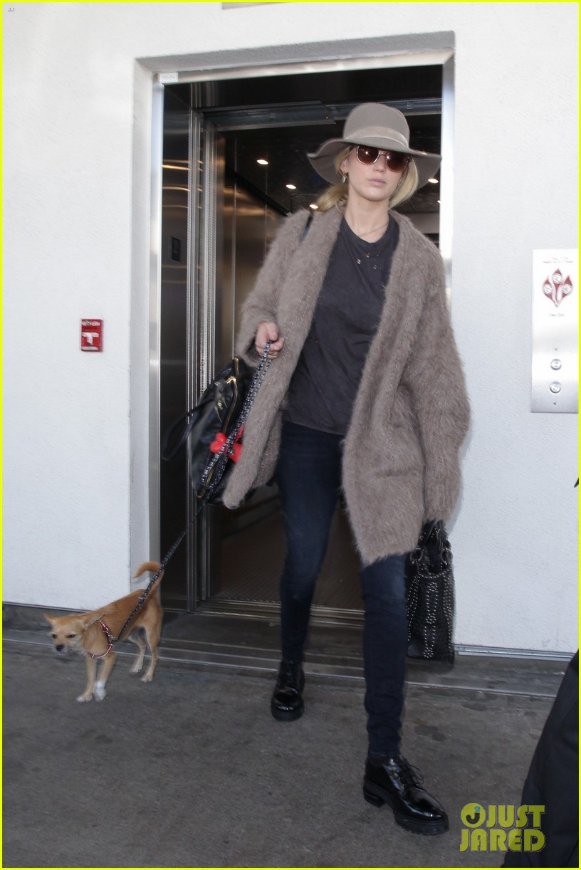 jennifer lawrence arrives at lax with her cute dog in tow 013966896
