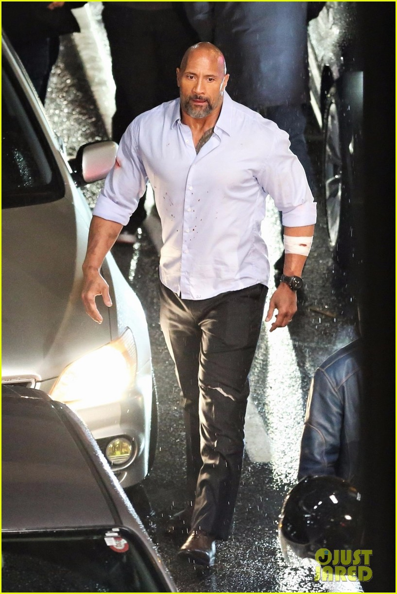 dwayne johnson looks jacked while filming arrest scene for 39 skyscraper 39 photo 3975225 dwayne. Black Bedroom Furniture Sets. Home Design Ideas