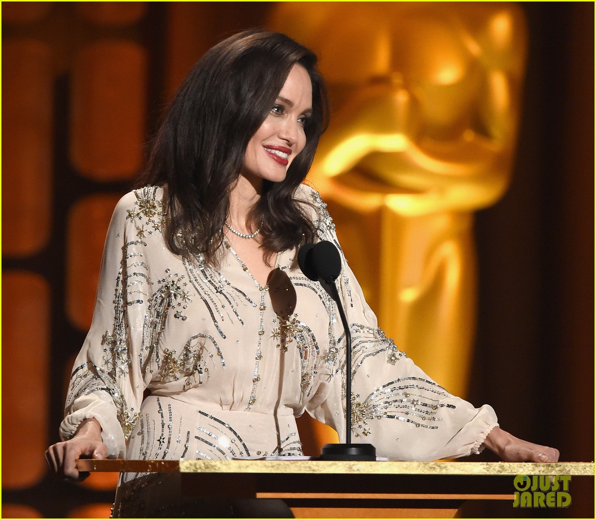 angelina jolie speaks on stage while presenting at governors awards 023985969