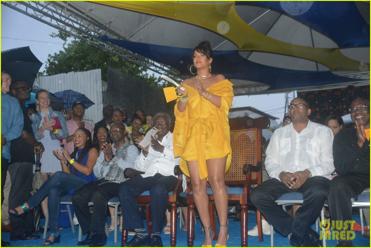 rihanna battles rainy weather at street naming ceremony in barbados 023994677