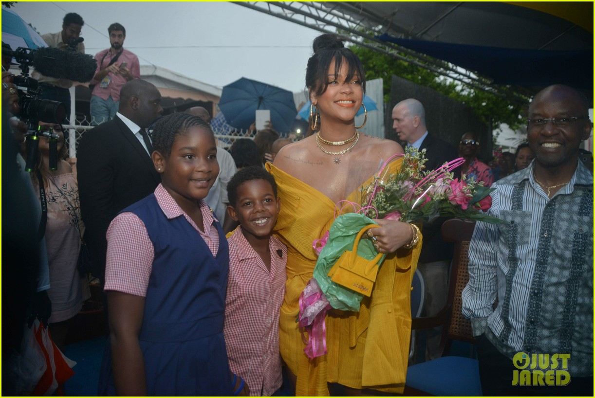 rihanna battles rainy weather at street naming ceremony in barbados 053994680
