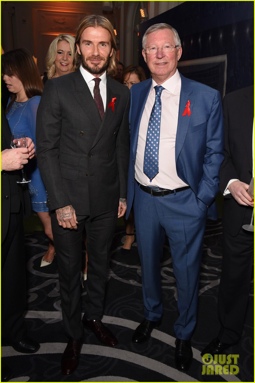 david beckham lets his long hair flow at world aids day event 013995843