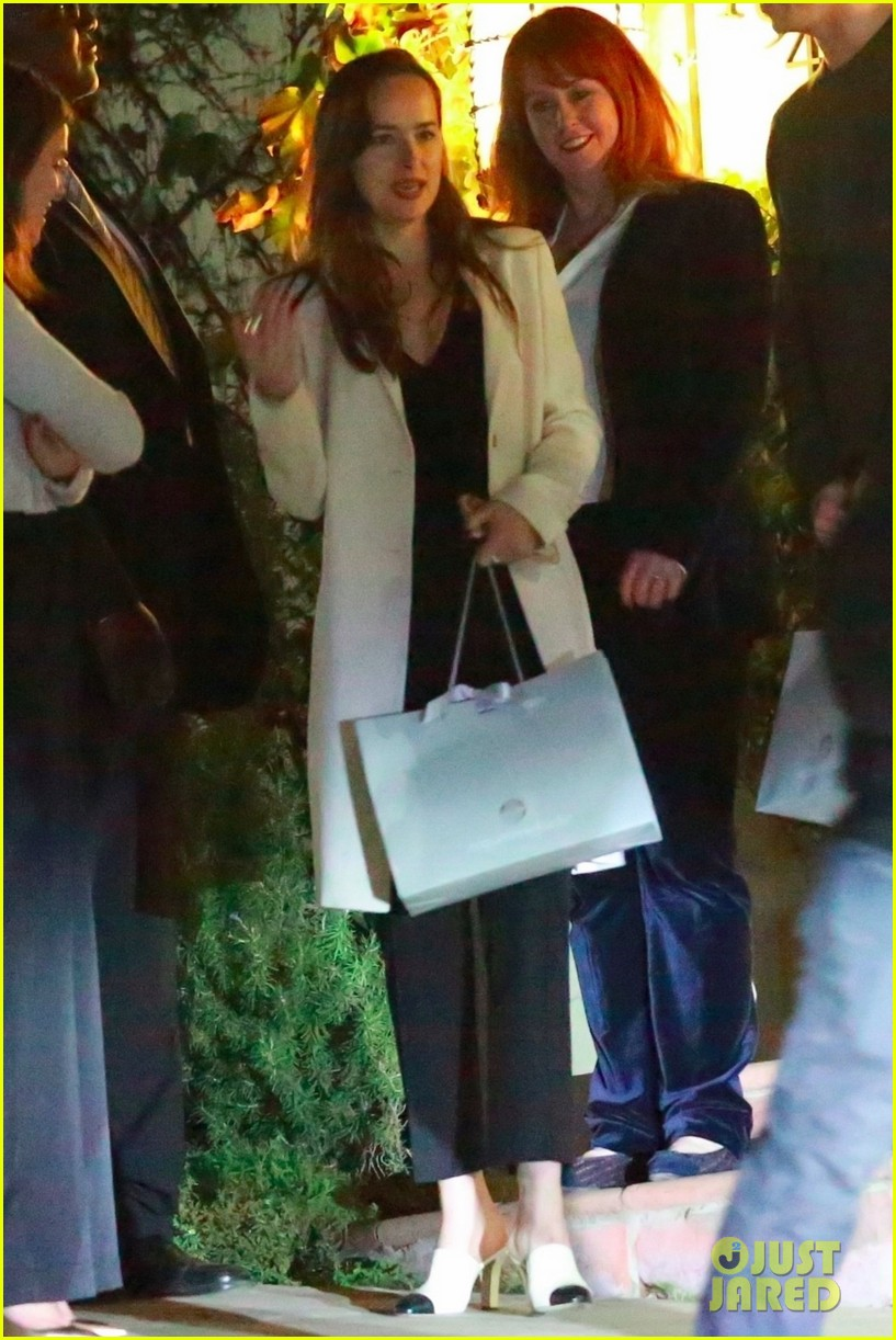 dakota johnson mom holiday party 053996645