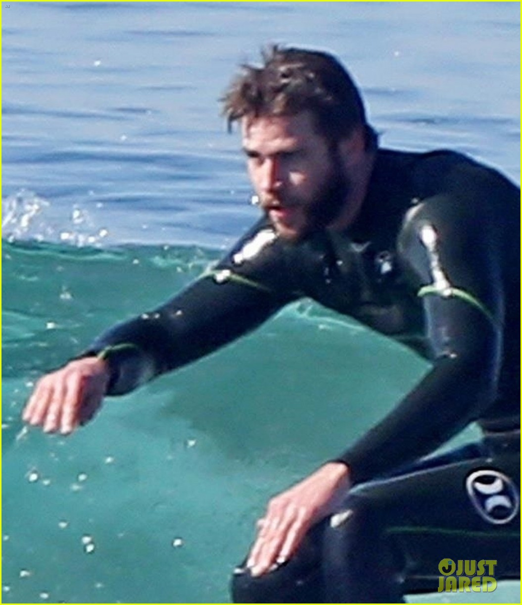 liam hemsworth gets shirtless after surfing in malibu see pics 044001823