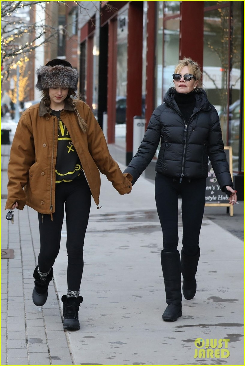dakota johnson mom melanie griffith hold hands in aspen 034004913