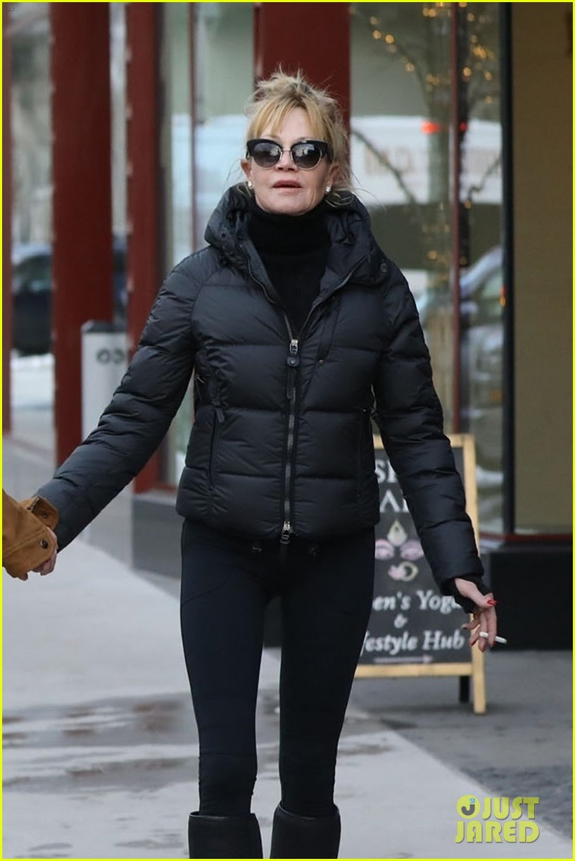 dakota johnson mom melanie griffith hold hands in aspen 044004914
