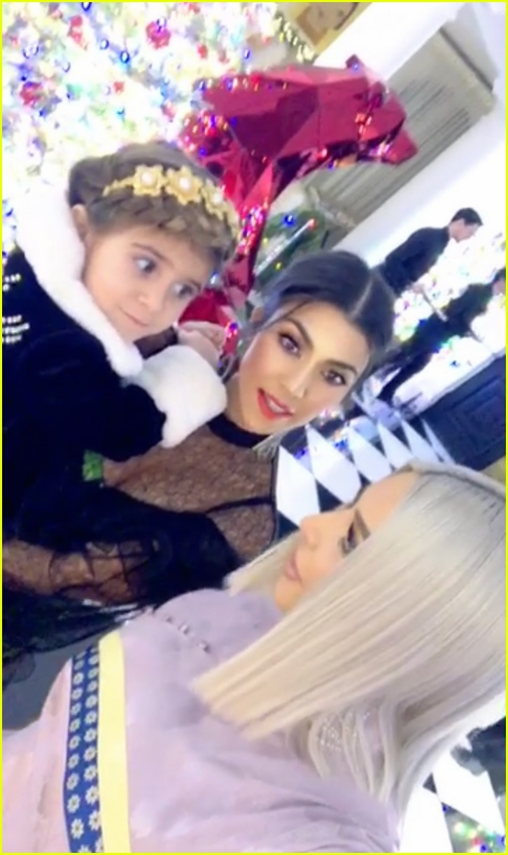 Khloe Kardashian Cradles Baby Bump at Christmas Eve Party!: Photo ...