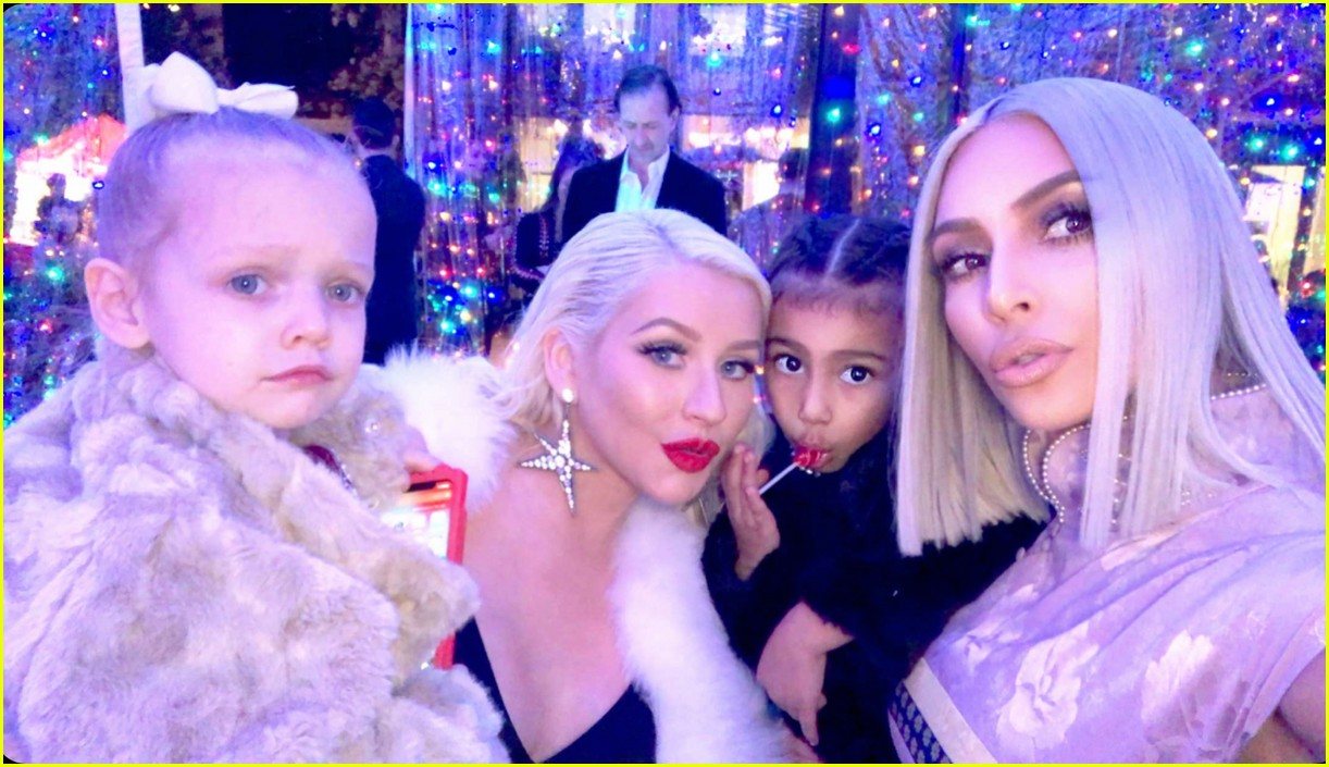 kim kardashian hangs with christina aguilera at christmas party 014004289