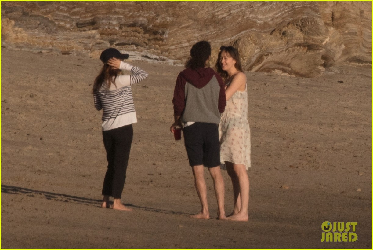 dakota johnson chris martin beach photos 444015242