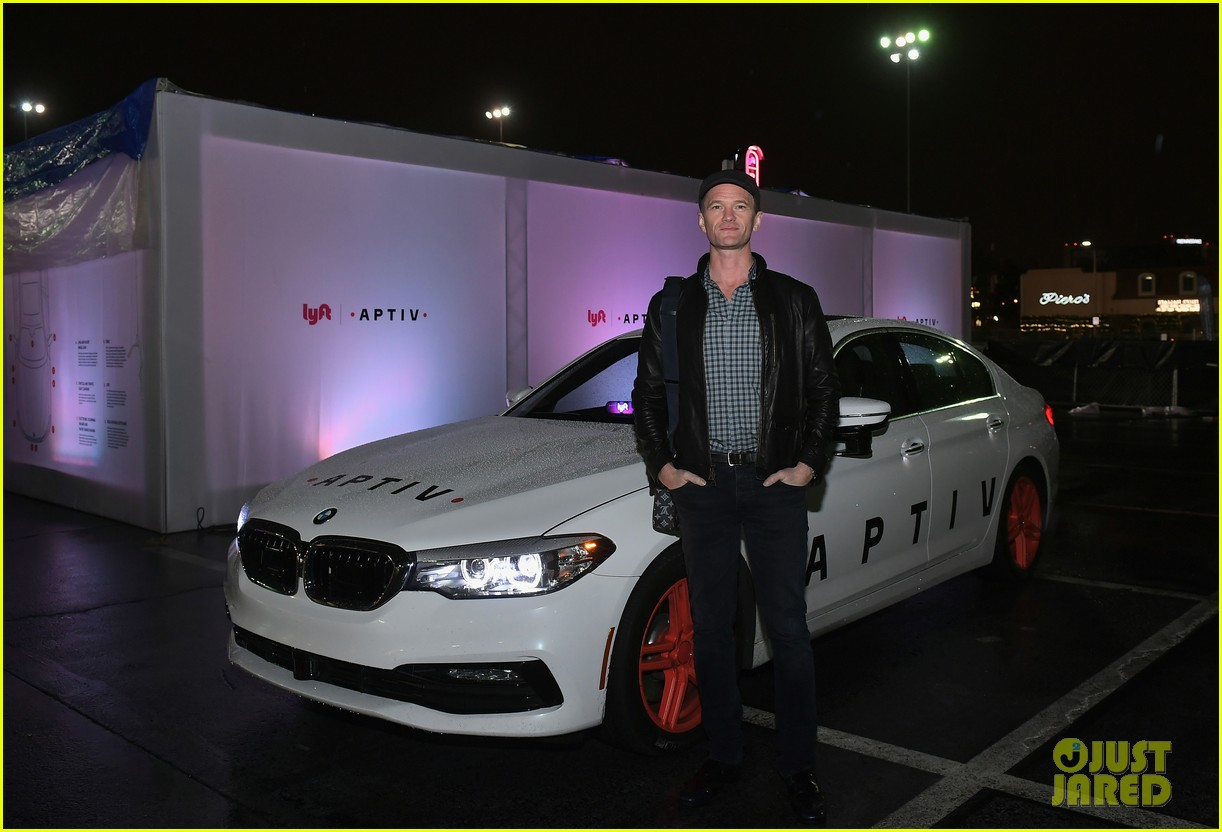 neil patrick harris checks out a self driving car with lyft 154012049