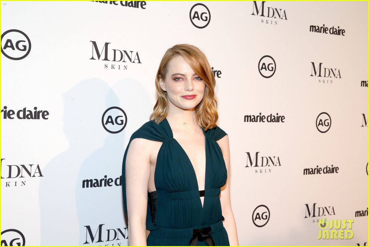emma stone goes glam in green for marie claire image makers awards 044013475