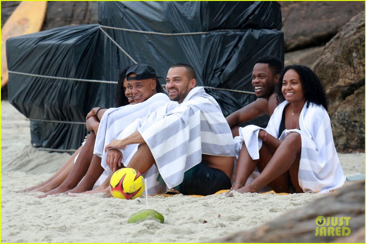 shirtless jesse williams shows off his abs on the beach 224008188
