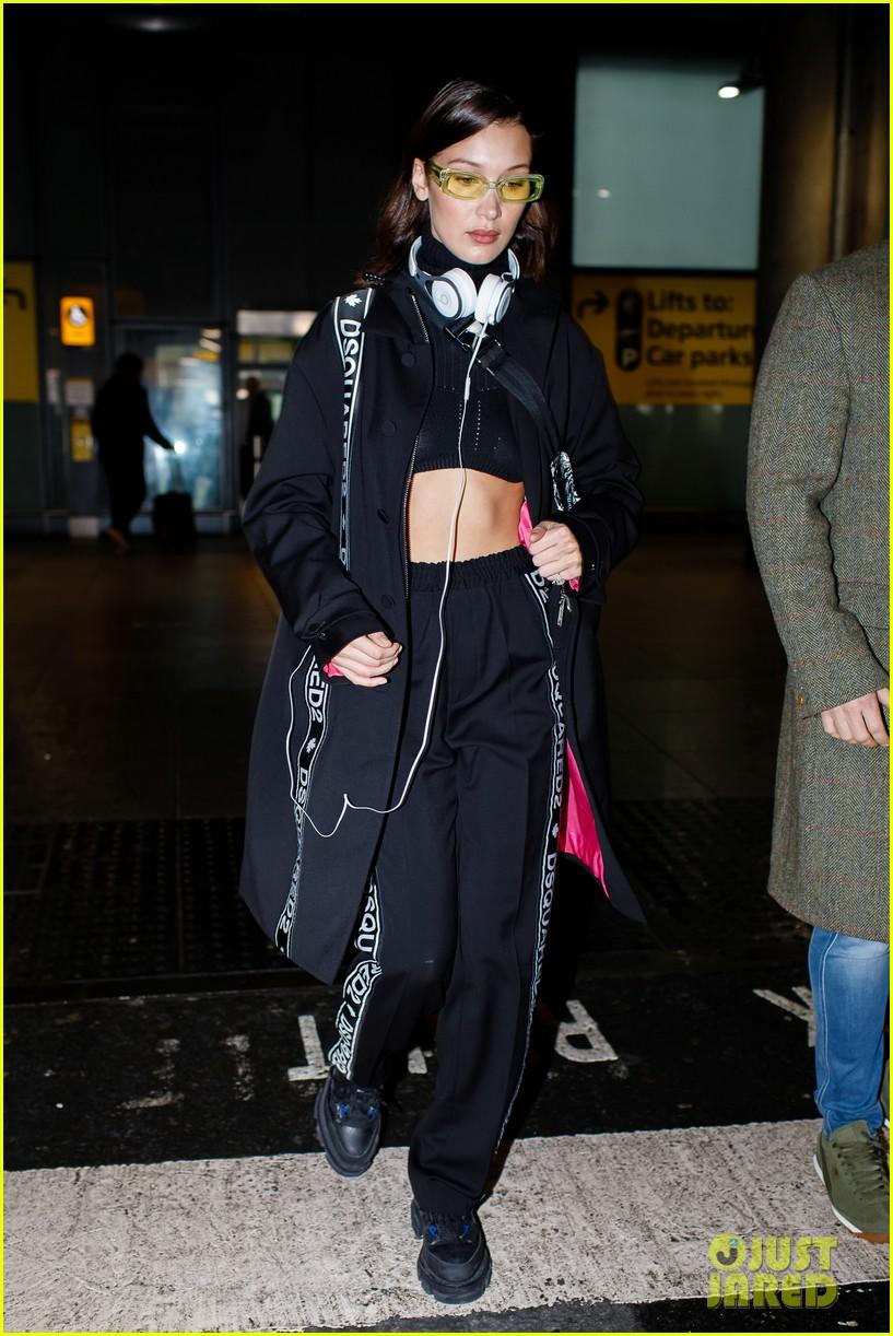 8ddbf65103e3 Bella Hadid Rocks a Crop Top While Arriving at Heathrow Airport ...