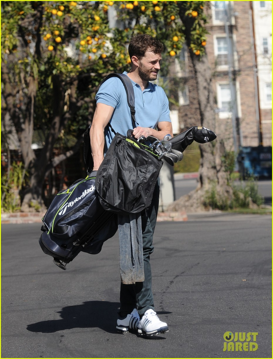 jamie dornan flaunts his biceps at the driving range 024032402