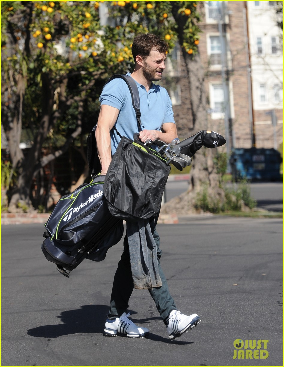 jamie dornan flaunts his biceps at the driving range 354032435