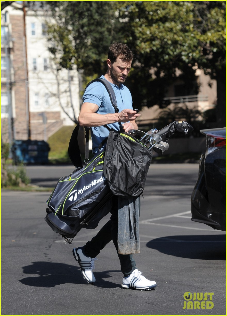 jamie dornan flaunts his biceps at the driving range 374032437