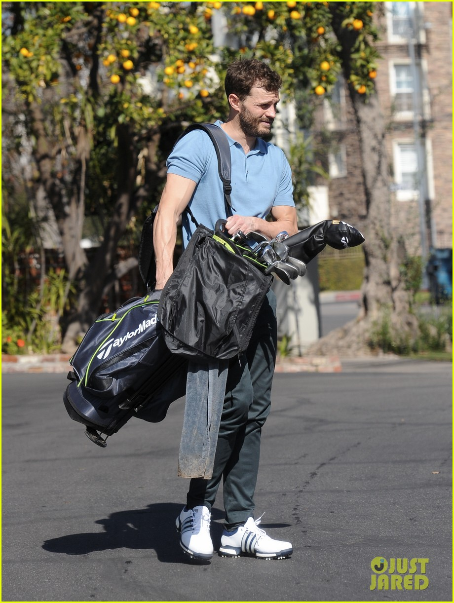 jamie dornan flaunts his biceps at the driving range 394032439