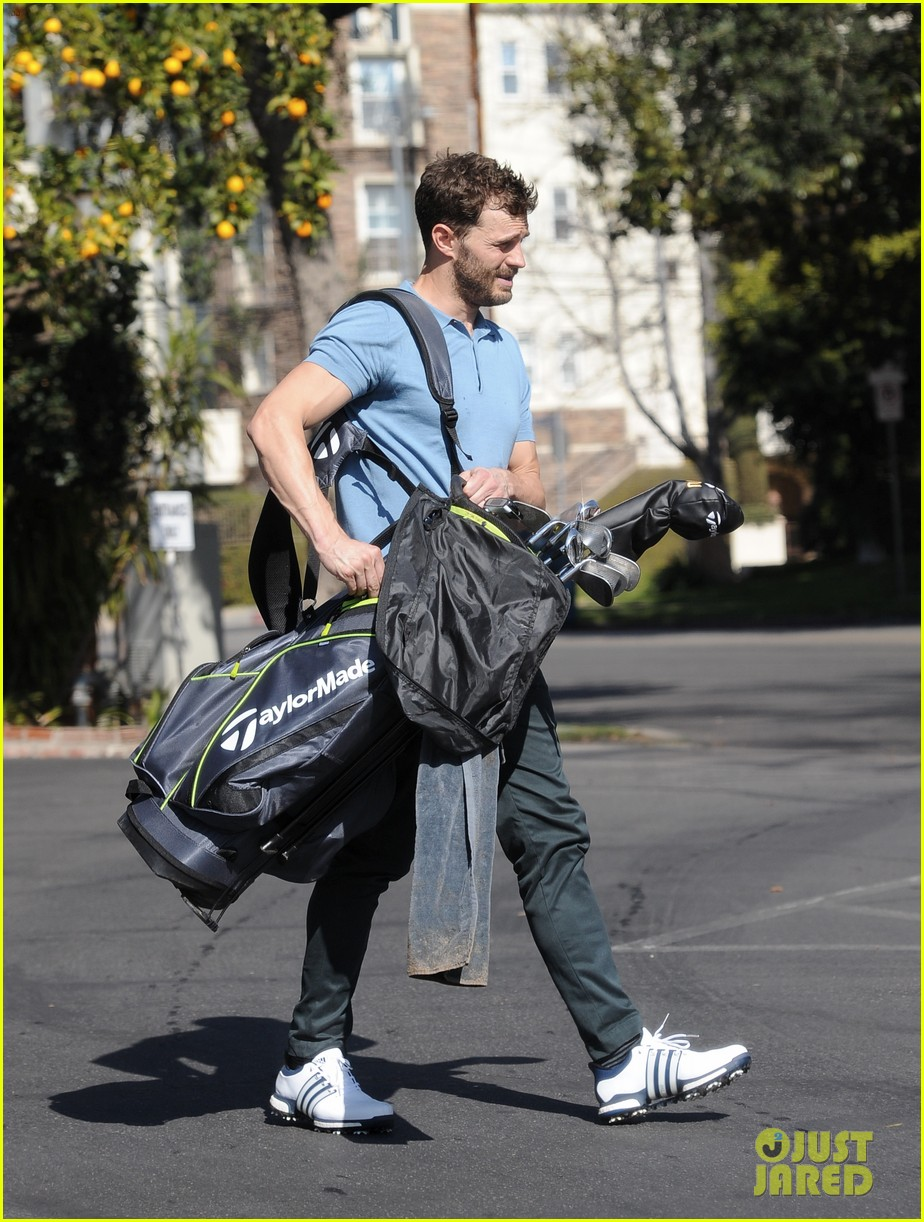 jamie dornan flaunts his biceps at the driving range 414032441