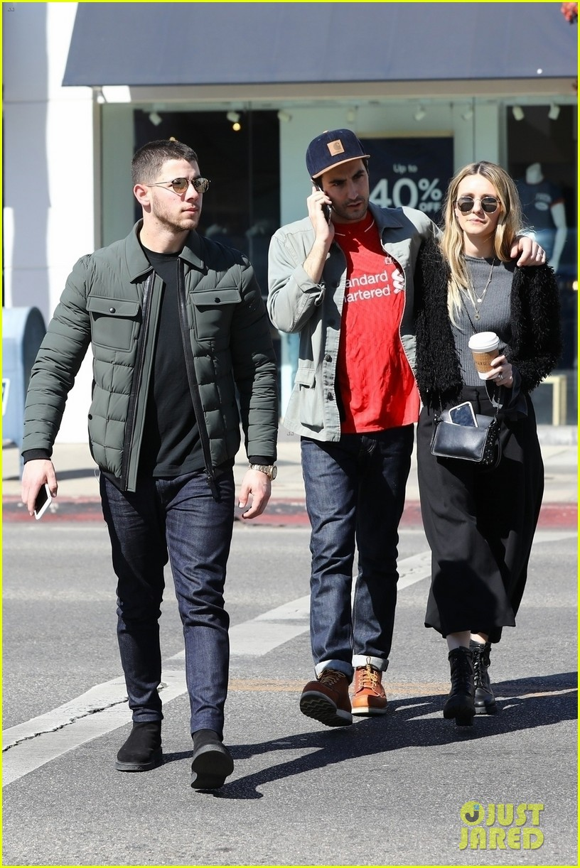 nick jonas stops for girl scout cookies in los angeles 014038940