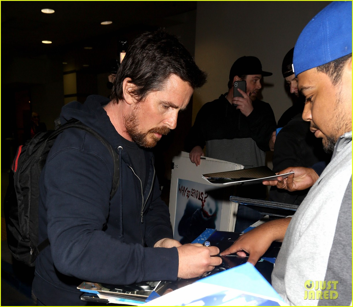 christian bale signs autographs for fans after touching down in la 034060144