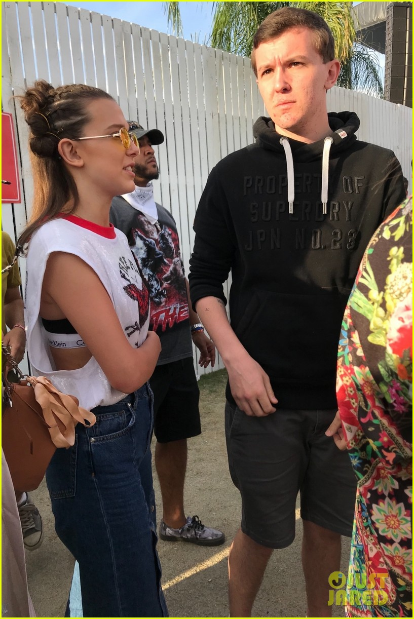 millie bobby brown checks out cardi bs coachella performance 034066039