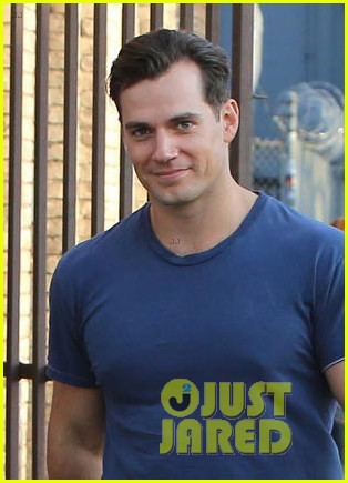 henry cavill shows off buff biceps taking his dog for a walk 054073791