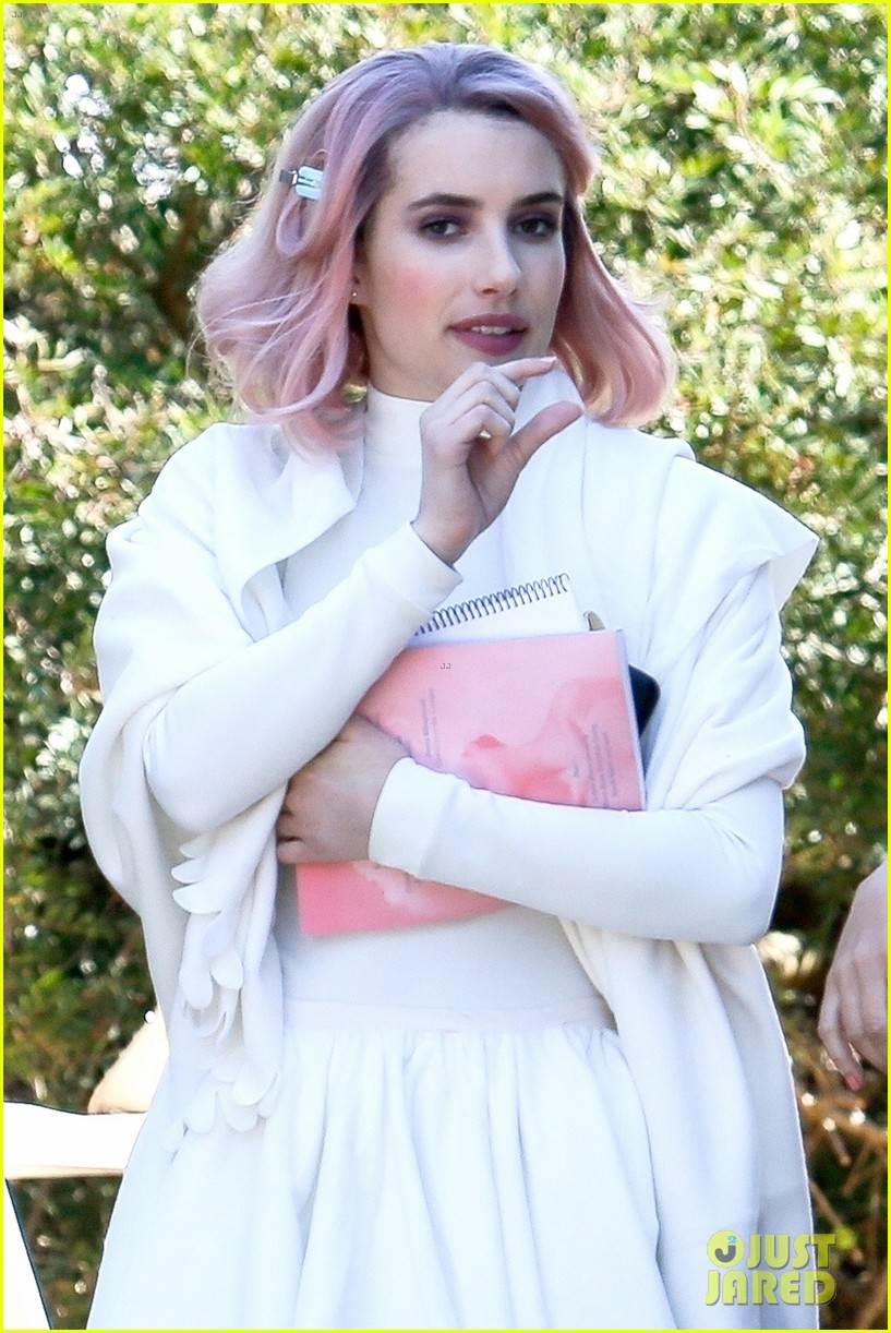 emma roberts rocks pink hair on the set of new movie