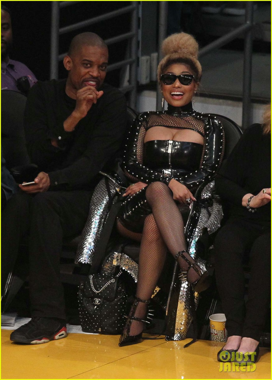 f0bf374d60 Nicki Minaj Sports Bold Studded Leather Look at Lakers Game  Photo ...