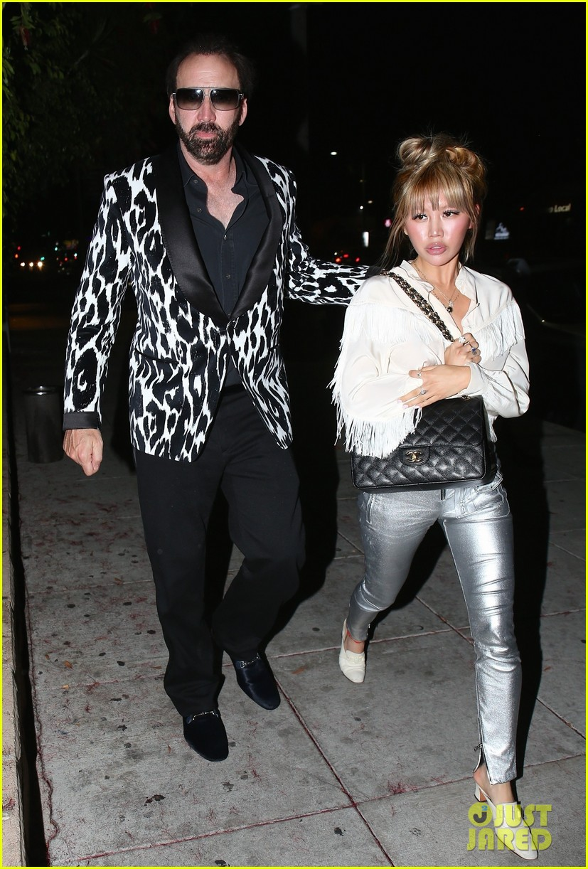 nicolas cage sports zebra print jacket for date with erika koike 074089630